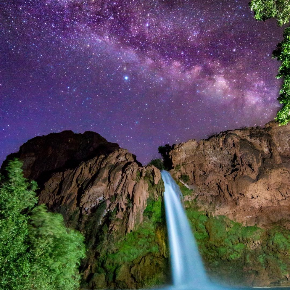 @tracyleephotos to be featured. Tag a friend who would like this image or this milkyway adventure.  From Tracy about this image:  Chasing the Milky Way around the skies has become a favorite pastime of mine. Havasupai Falls was my destination of choice this month both for its beauty as well as the lack of Milky Way photos in this location (I've only seen a few!) #  My journey began with 15 friends and an 11 mile backpack into the Grand Canyon. I definitely overpacked and have blisters as a result of this effort. Weather forecast reported cloudy skies while we were there 2 nights but I kept optimistic and when our crew woke up at 2am, there wasn't a cloud in the sky. 8 of us and a dog headed down to the most famous of the four sets of falls, Havasu to photograph the celestial being rising above. We each went a different direction with a different composition in mind and for me, I balanced on a free hanging log (about 5ft high) to set up my tripod for this shot. Thank you to @mr_awesome717_photography for bringing his @lux_pro_flashlights because they lit up an otherwise very dark scene