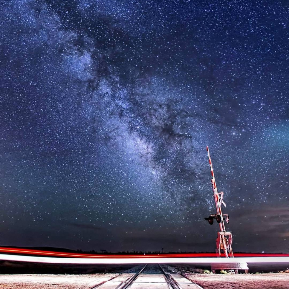 REPOST: @davidcrowlphotography to be featured! Tag a friend who might enjoy this photo and this milky way journey!  During spring I chase storms on the Great Plains. I encounter lots of places by day that may be great spots to shoot the night sky. I note them down and return later if I pass that way again. This is one such spot outside of Limon, CO on a seldom used highway. The original idea was to get a train and the Milky Way, but on this beautiful warm night in May 2015 the angle was wrong and no trains came! So instead, I setup to get the motion of a car and used the tracks as leading lines. A car went by about every 15 minutes or so, and this image was the second one after a practice frame and adjustments. The way the road and tracks lit up was better than any light painting could be. This is a single exposure with a Canon 6D, 16-35L. F2.8, ISO3200, 25 seconds