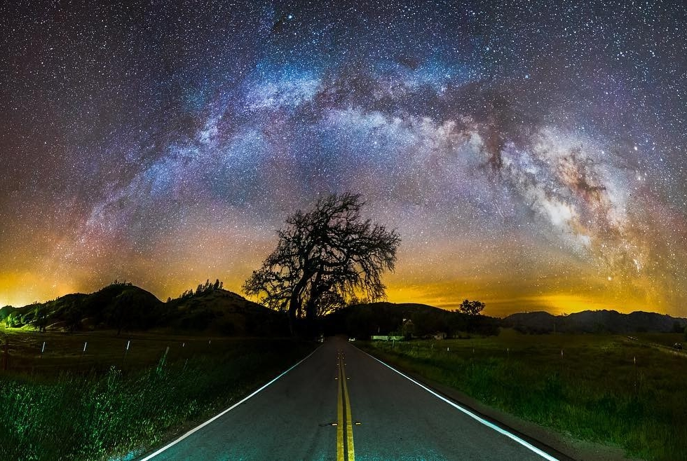 REPOST: @permagrinfilms to be featured! Tag a friend who might enjoy this photo and this milky way journey!  From Marc about this image:  I took this panorama around 4am when there were no cars on the street. I only saw one car and could hear it from miles away so I had a lot of time to move out of the way.  The chick stopped to ask me what I was doing. I told her I was shooting the Milky Way and she looked at me like I was a crazy person.  She took off and I continued to shoot my shots. A minute later I could hear her way in the distance turning around. She drove passed me like 5 times, turning around a couple miles down the street. I barely had enough time to capture all 12 photos because this chick kept in ruining my shot! Luckily I managed to shoot off all 12 before it started getting light out and more cars came driving down the street. I know I have a couple screws loose but that chick was the crazy person.  Original Post:  Milky Way Panorama near Pinnacles National Park. Clear skies predicted by ‪#‎Escaype‬. Shooting alongside @aroradeepanshu. Big thanks to the rest of the Escaype Crew for being a wealth of knowledge!  Shot achieved using an @emotimo and attaching my Sony A7S vertically. Settings: f/3.1, ISO 6400, 20 seconds, 14mm Rokinon cinema lens. 12 shots (3 rows, 4 columns). Merged and colored in Adobe Photoshop Lightroom with additional adjustments made in Photoshop.  This is my first attempt at capturing the entire band of the Milky Way across the sky. Shout out to @shainblumphotography for the inspiration and support