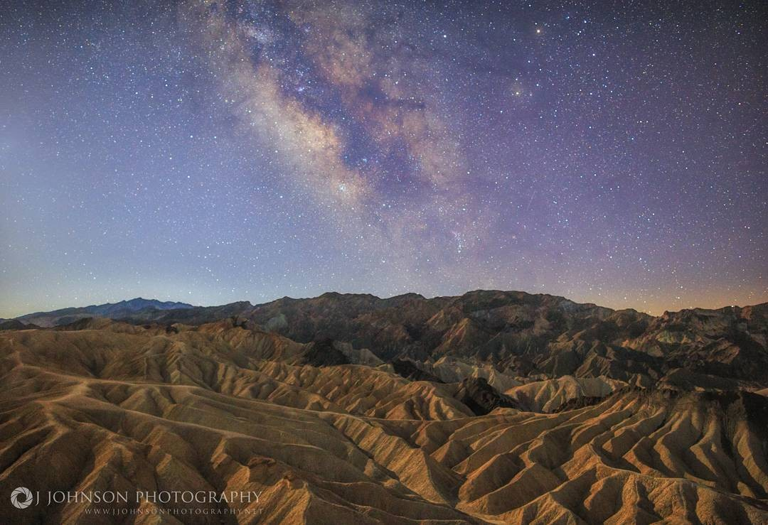 REPOST: @jjohnson_photography to be featured! Tag a friend who might enjoy this photo and this milky way journey!  Original Post: ◾Location: Death Valley Natl. Park ◾Settings 24mm• f/2 • 15sec • ISO3200 ◾Canon 6D • Rokinon 24mm 1.4 ▪▪▪▪▪▪▪▪▪▪▪▪▪▪▪▪▪▪▪▪▪▪▪▪▪▪▪▪▪▪▪▪▪▪▪▪▪▪▪▪▪▪▪▪▪▪▪▪▪▪▪▪▪▪▪▪▪▪▪▪▪▪▪▪▪▪▪▪▪▪▪▪▪▪▪▪ Milky Way shining bright over Zabriskie Point with a waning crescent Moon lighting up the foreground. The faint blue color to your left is an indication that daylight is coming soon. This is one single exposure. I raised the shadows in PS a little but not much cause the Moon did most of the light painting for me