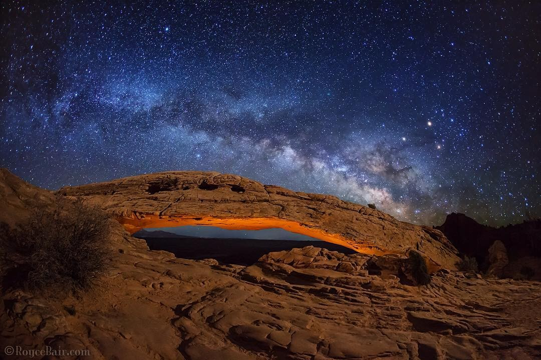 "REPOST: @roycebairphoto to be featured! Tag a friend who might enjoy this photo and this milky way journey!  Last week, after 3 years of trying, I was finally successful at getting the perfect evening weather for the Milky Way over Mesa Arch, in Canyonlands Nat'l Park, Utah. The horizontal alignment of the MW is best in April for this low arch. I balanced subtle lighting for the foreground and underneath the arch to match a single 25-seconds exposure for the night sky — all done in one shot. Three hours later, the ""sunrise"" crowd began to descend upon me and compete for the ""sweet spot"" I had used earlier in the night"