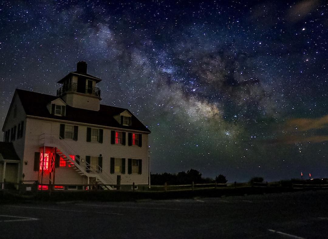 REPOST: @leboucanier1 to be featured! Tag a friend who might enjoy this photo and this milky way journey!  This shot was taken on 4/9/16 around 2:30am at the retired Coast Guard station in Eastham, MA. It is the result of an Insta meet organized by @honoryourrhythm @wickedcapecod @capecloth and myself. The enticing opportunity to shoot the milky way brought over 30 folks from all over Cape Cod and parts of New England. The spot was chosen for its lack of light pollution, a panoramic beachfront, as well as the CG station in the foreground (whose exit signs shine red through the windows). Please check out to see all the photos from the meetup